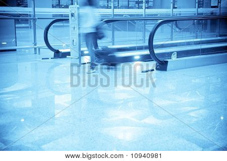 Business man walking in the airport
