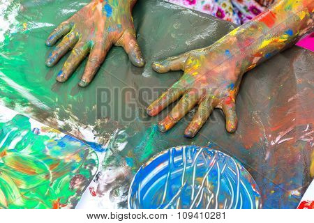 Top View Of Kids Painted Hands At Table.