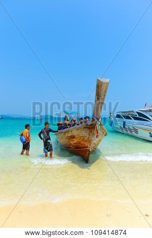 Longtail Boat And Tourists On The Sea Tropical Beach. Andaman Sea