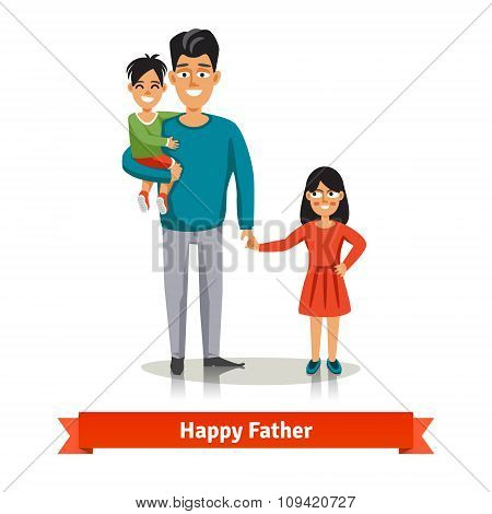Father holding his son and daughter's hand