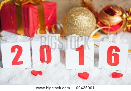 Greeting card with New Year gifts and snow