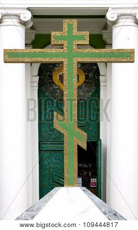 Big Green Christian Golden Cross At Entrance To Temple