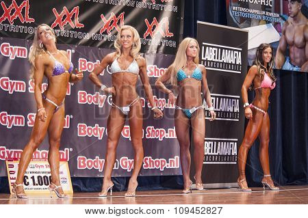 Female Bikini Fitness Contestants Showing Their Best In A Lineup