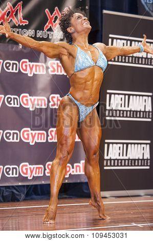 Female Bodybuilder In Happy And Sexy Pose And Blue Bikini