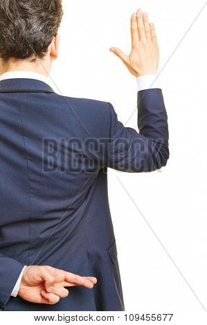 Business manager promising an oath with crossed fingers behind his back