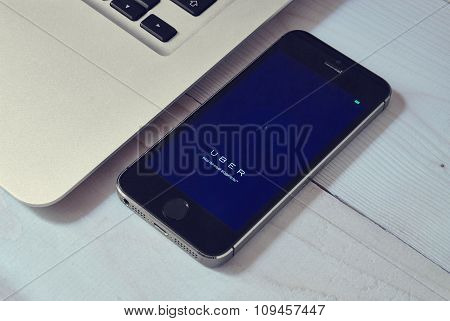 Iphone 5S On Laptop With Mobile Application For Uber On The Screen