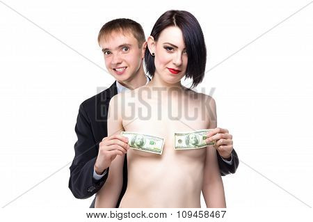Woman and man cover her breast with dollars