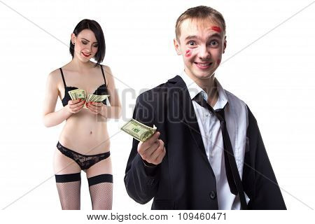 Man in kisses and woman holding money