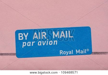 LONDON UK - CIRCA MAY 2015: by air mail - par avion tag by the Royal Mail international mail tag written in English and French