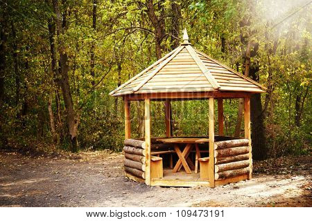 Wooden garden house, alcove in the forest