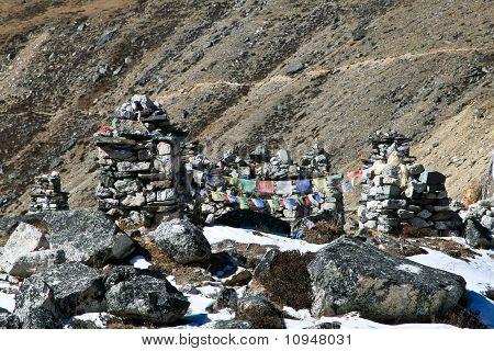 Chukpilhara Memorial on a trek to Everest, Khumbu, Nepal. Grave stones in memory of climbers. poster