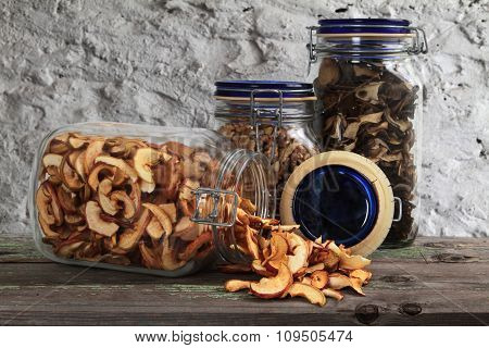 Dried fruits and nuts in a glass jar on a table