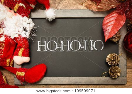 Blackboard with the text: HO-HO-HO in a christmas conceptual image