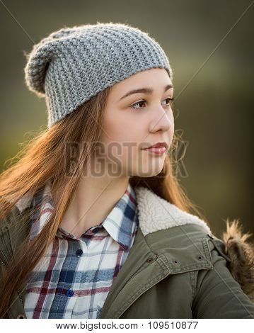 Beautiful Teenage Girl In Warm Coat And Wooly Hat