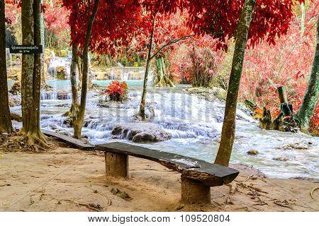 Wooden Bench At Rainforest Waterfall, Tat Kuang Si Waterfall At Luang Prabang, Loas.