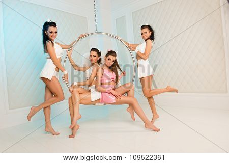 Four Sexy Cute Girls With Roand Chair
