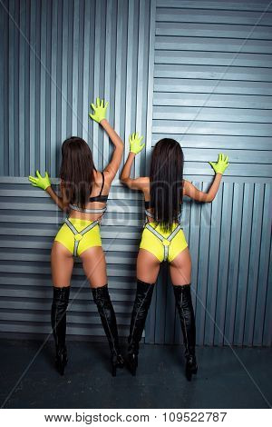 Rear View Of Two Sexy Girls In Stage Costumes