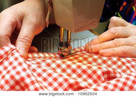 Hands Stitching Denim Cloth With A Sewing Machine