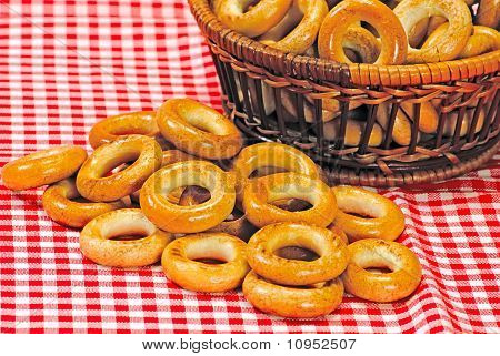 Basket With Bread Ring On A Motley  Background