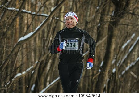 happy man average forest runs on track in winter Park