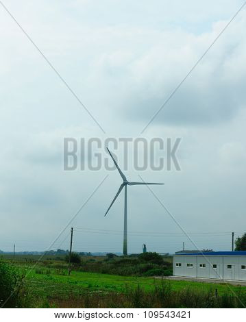 Wind-driven Generator In The Middle Of A Field