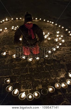 Child with candles on the square