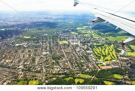 Big airplane begins to decline and prepares for landing in Heathrow Airport with soft focus . London. UK poster