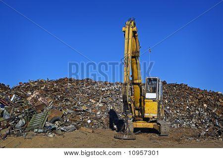 Yellow Crane & Scrap Metal Piles