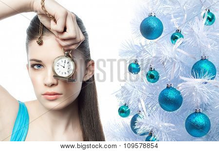 closeup portrait of attractive  caucasian  woman brunette isolated on white studio shot lips face hair head and shoulders looking at camera watches time christmas tree new year
