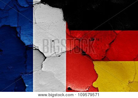 Flags Of France And Germany Painted On Cracked Wall