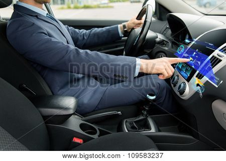 transport, business trip, navigation, technology and people concept - close up of young man in suit driving car and using gps navigator system on board computer screen