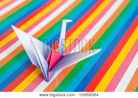 Origami Bird On A Colorful Background.