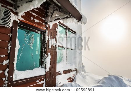 Snow-covered House In The Mountains After Snowfall