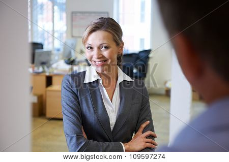 Businesswoman Being Flirtatious Towards Male Colleague