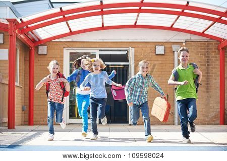 Schoolchildren Running Into Playground At End Of Class