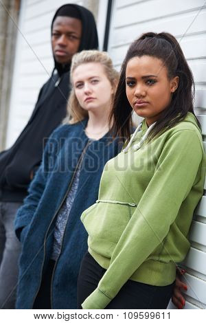 Group Of Teenagers Hanging Out In Urban Environment