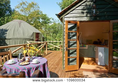 Exterior Of Beautiful Holiday Yurt With Breakfast Table poster