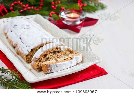 Stollen. Traditional German Christmas Cake With Dried Fruits And Icing Sugar.