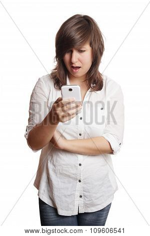woman staring at smartphone in shock