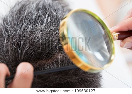 Close Up Of Dermatologist Checking Patient's Hair Through Magnifying Glass poster