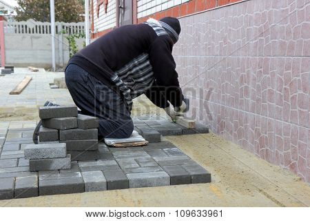 Worker Installs Paving Slabs