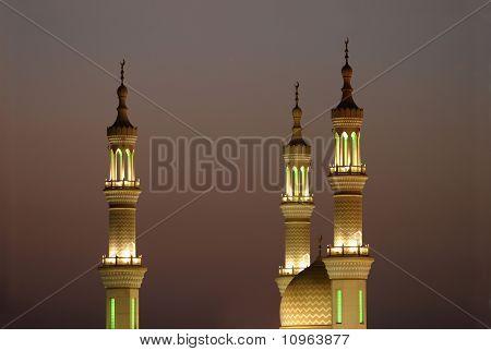 The minarets of Sheikh Zayed Mosque at sunset Ra's al-Khaimah United Arab Emirates poster