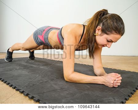 Woman Doing Elbow Plank