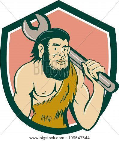 Neanderthal Caveman With Spanner Crest Cartoon