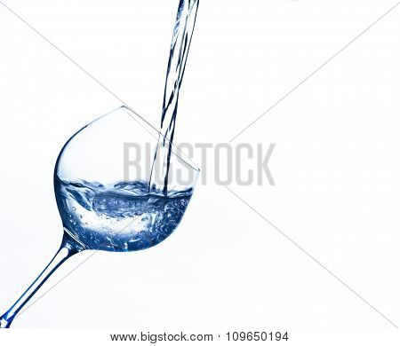 pure and clean water is filled into a glass. drinking water, water glass, glass, dehydration, dehydrated, dehydration in a teacup.