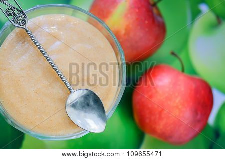 Homemade Apple Sauce With Cinnamon And Apple In The Back