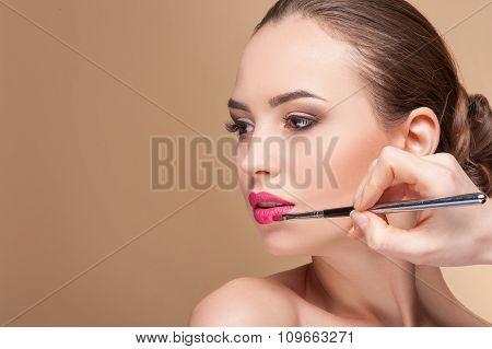 Skillful make-up artist is serving her customer