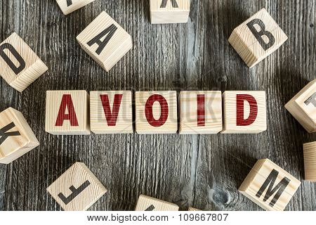Wooden Blocks with the text: Avoid
