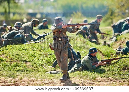 LOSHANY, BELARUS - MAY 10: Re-enactment of the WWII attack battle by history club members as German Nazi soldiers during historical show at Stalin Line memorial on May 10, 2015 in Loshany, Belarus