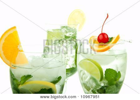 Citrus Mojito cocktails with light rum vodka gin lime spring of mint simple soda orange maraschino cherry and syrup in cocktail glasses isolated on a white background poster